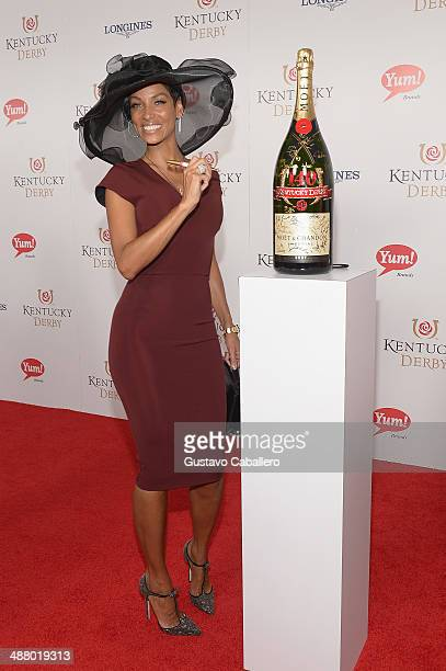 Nicole Murphy toasts with Moet Chandon at the 140th Kentucky Derby at Churchill Downs on May 3 2014 in Louisville Kentucky