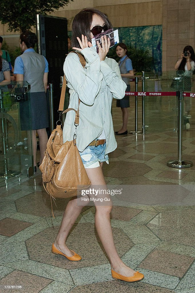 Nicole of South Korean girl group Kara is seen on departure at Gimpo International Airport on July 18, 2013 in Seoul, South Korea.