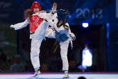 Nicole Palma of USA competes with Ruxandra Rodgers of Canada during a women's 57 kg combat of WTF World Taekwondo Championships 2013 at the...