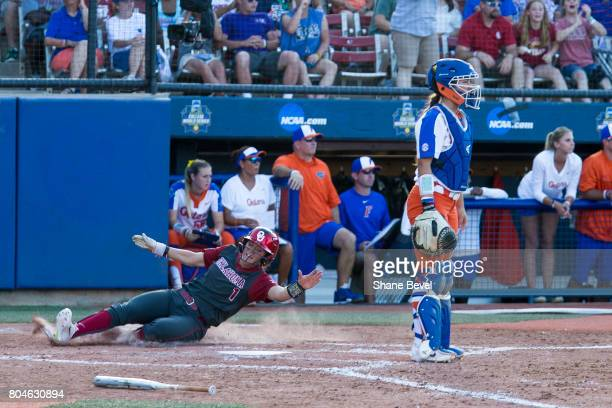 Nicole Pendley of the University of Oklahoma slides into home plate during the Division I Women's Softball Championship held at ASA Hall of Fame...