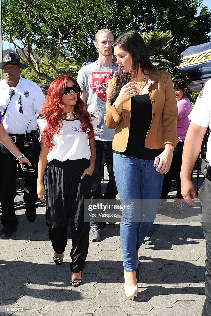 Nicole Polizzi (L) and Jennifer Farley visit 'Extra' at Universal Studios Hollywood on October 15, 2013 in Universal City, California.