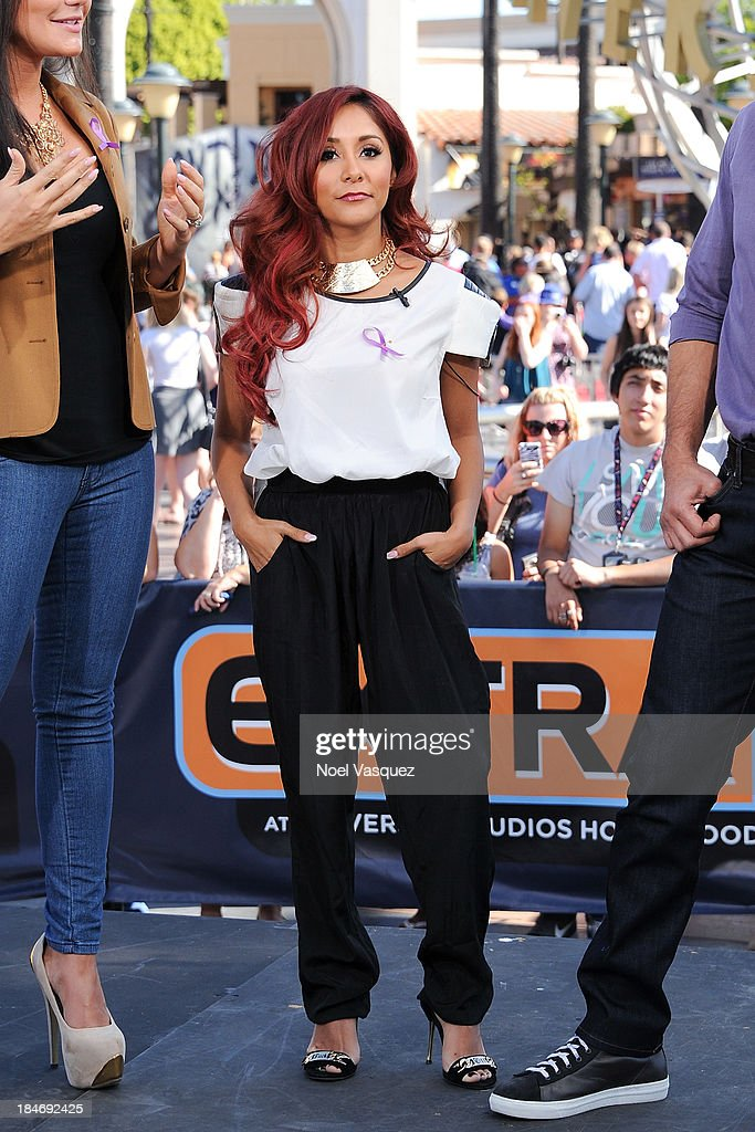 <a gi-track='captionPersonalityLinkClicked' href=/galleries/search?phrase=Nicole+Polizzi&family=editorial&specificpeople=6586259 ng-click='$event.stopPropagation()'>Nicole Polizzi</a> visits 'Extra' at Universal Studios Hollywood on October 15, 2013 in Universal City, California.