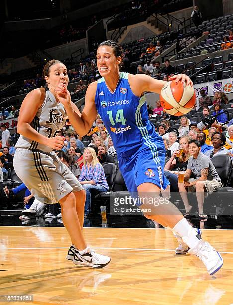 Nicole Powell of the New York Liberty drives against Becky Hammon of the San Antonio Silver Stars at the ATT Center on September 18 2012 in San...