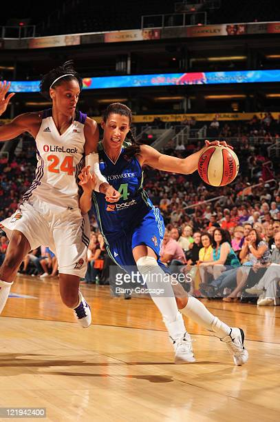 Nicole Powell of the New York Liberty drives against DeWanna Bonner of the Phoenix Mercury on August 23 2011 at US Airways Center in Phoenix Arizona...