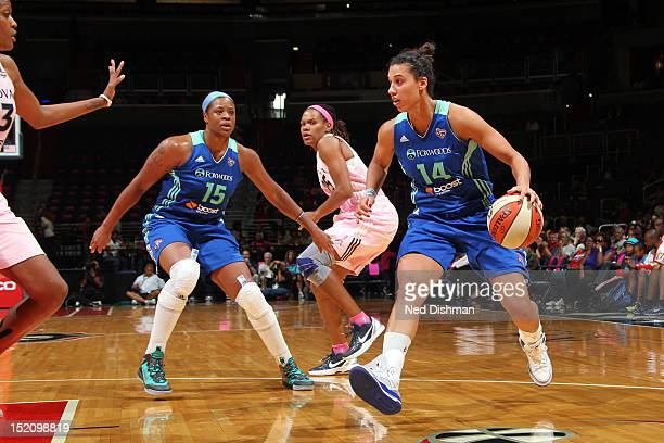 Nicole Powell of the New York Liberty drives against Monique Currie of the Washington Mystics at the Verizon Center on September 14 2012 in...