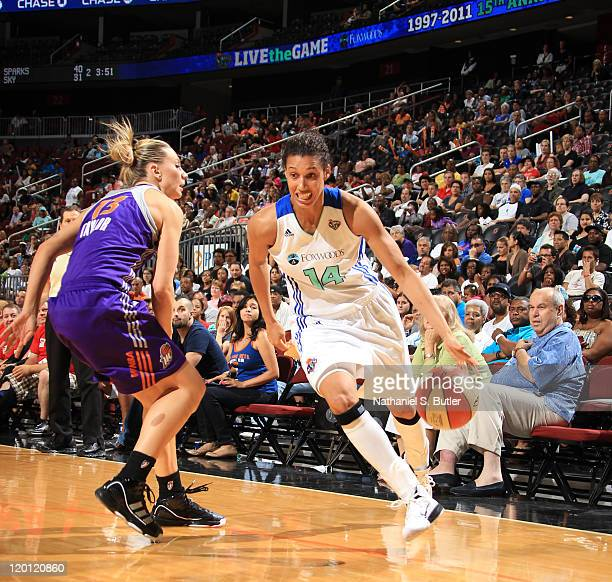 Nicole Powell of the New York Liberty drives against Penny Taylor of the Phoenix Mercury during a game on July 30 2011 at the Prudential Center in...