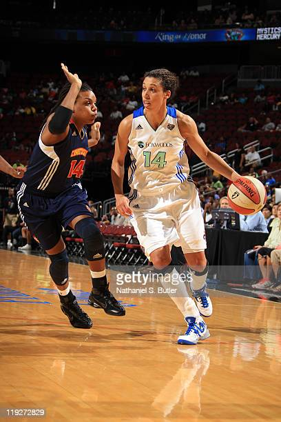 Nicole Powell of the New York Liberty drives against Tan White of the Connecticut Sun during a game on July 15 2011 at the Prudential Center in...