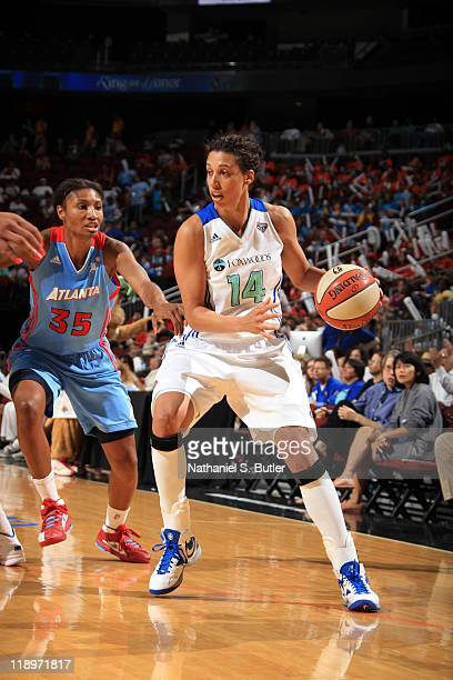 Nicole Powell of the New York Liberty drives by Angel McCoughtry of the Atlanta Dream during a game on July 13 2011 at the Prudential Center in...