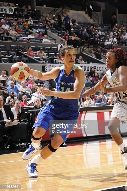 Nicole Powell of the New York Liberty drives the ball against Danielle Robinson of the San Antonio Silver Stars at ATT Center on July 8 2011 in San...