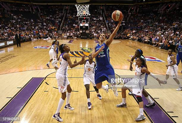 Nicole Powell of the New York Liberty lays up a shot past DeWanna Bonner Marie FerdinandHarris and Candice Dupree of the Phoenix Mercury during the...