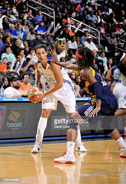 Nicole Powell of the New York Liberty prepares to pass the basketball against Shavonte Zellous of the Indiana Fever in Game Two of the Eastern...