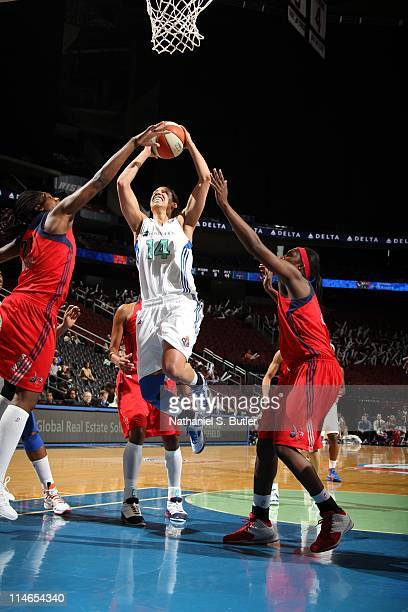 Nicole Powell of the New York Liberty shoots against Nicky Anosike of the Washington Mystics during a game on May 25 2011 at the Prudential Center in...