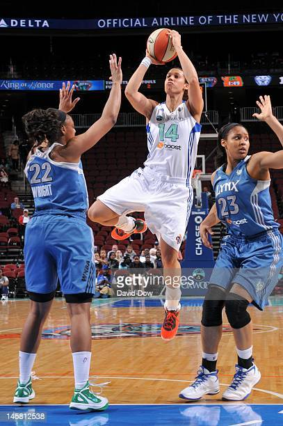 Nicole Powell of the New York Liberty shoots the ball against Monica Wright and Maya Moore of the Minnesota Lynx during the WNBA game on May 22 2012...