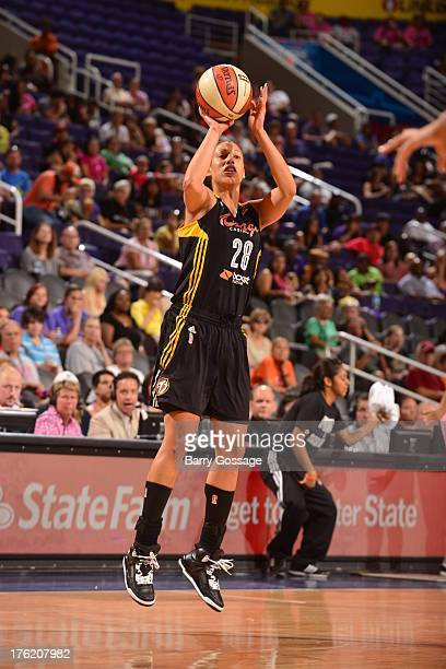 Nicole Powell of the Tulsa Shock attempts a shot during a game against the Phoenix Mercury on August 11 2013 at US Airways Center in Phoenix Arizona...