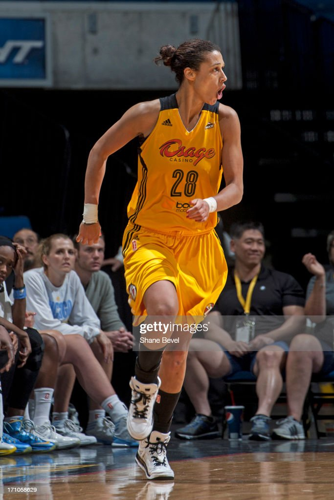 <a gi-track='captionPersonalityLinkClicked' href=/galleries/search?phrase=Nicole+Powell&family=editorial&specificpeople=217548 ng-click='$event.stopPropagation()'>Nicole Powell</a> #28 of the Tulsa Shock celebrates against the Chicago Sky during the WNBA game on June 20, 2013 at the BOK Center in Tulsa, Oklahoma.