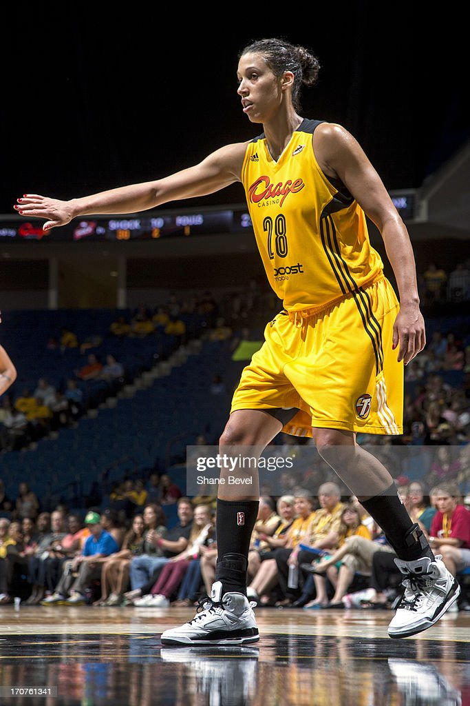 <a gi-track='captionPersonalityLinkClicked' href=/galleries/search?phrase=Nicole+Powell&family=editorial&specificpeople=217548 ng-click='$event.stopPropagation()'>Nicole Powell</a> #28 of the Tulsa Shock plays defense during the WNBA game against the Minnesota Lynx on June 14, 2013 at the BOK Center in Tulsa, Oklahoma.