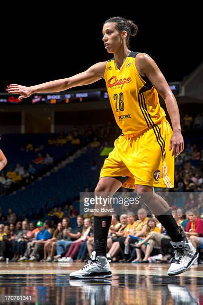 Nicole Powell of the Tulsa Shock plays defense during the WNBA game against the Minnesota Lynx on June 14 2013 at the BOK Center in Tulsa Oklahoma...