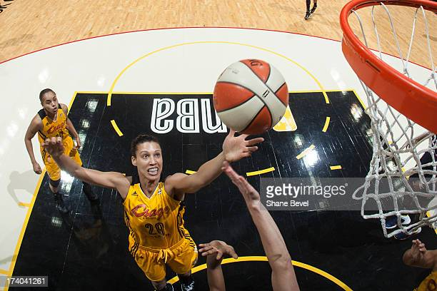 Nicole Powell of the Tulsa Shock shoots against the Connecticut Sun during the WNBA game on July 19 2013 at the BOK Center in Tulsa Oklahoma NOTE TO...