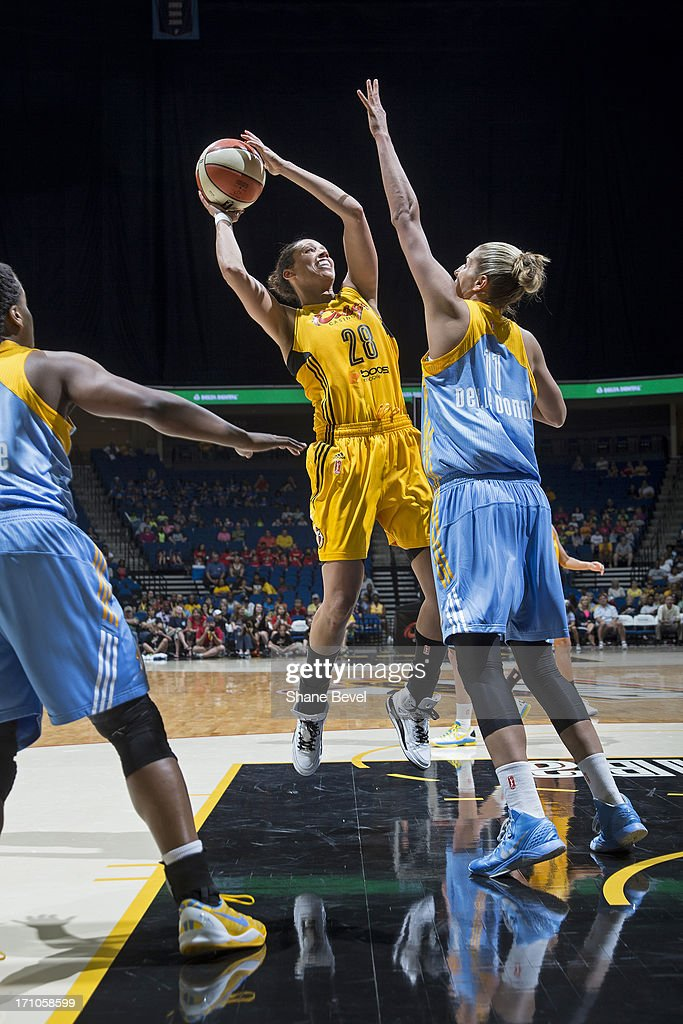 <a gi-track='captionPersonalityLinkClicked' href=/galleries/search?phrase=Nicole+Powell&family=editorial&specificpeople=217548 ng-click='$event.stopPropagation()'>Nicole Powell</a> #28 of the Tulsa Shock shoots the ball against the Chicago Sky during the WNBA game on June 20, 2013 at the BOK Center in Tulsa, Oklahoma.