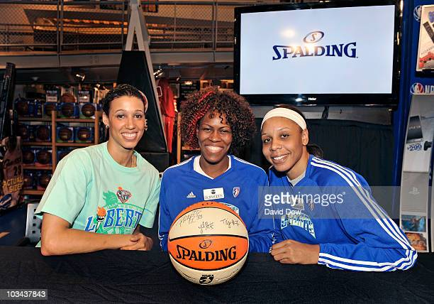 Nicole Powell Taj McWilliamsFranklin and Plenette Pierson of the New York Liberty pose for a photograph during an in store sponsored Spalding...