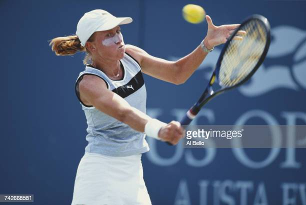 Nicole Prat of Australia makes a backhand return against Arantxa Sanchez Vicario during their Women's Singles second round match at the US Open...