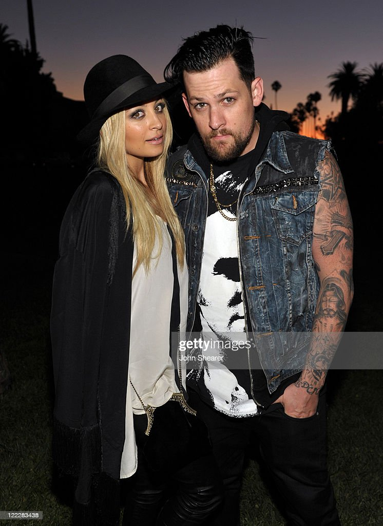 <a gi-track='captionPersonalityLinkClicked' href=/galleries/search?phrase=Nicole+Richie&family=editorial&specificpeople=201646 ng-click='$event.stopPropagation()'>Nicole Richie</a> (L) and musician <a gi-track='captionPersonalityLinkClicked' href=/galleries/search?phrase=Joel+Madden&family=editorial&specificpeople=202933 ng-click='$event.stopPropagation()'>Joel Madden</a> attend the Band of Outsiders, NET-A-PORTER and MRPORTER.com summer event at the Hollywood Forever cemetery on August 24, 2011 in Hollywood, California.
