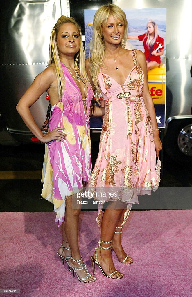 Nicole Richie (L) and Paris Hilton aririve for the 'Simple Life 2' Welcome Home Party at The Spider Club on April 14, 2004 in Hollywood, California.