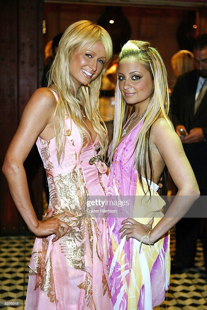 Nicole Richie and Paris Hilton (L) aririve for the 'Simple Life 2' Welcome Home Party at The Spider Club on April 14, 2004 in HHollywood, California.