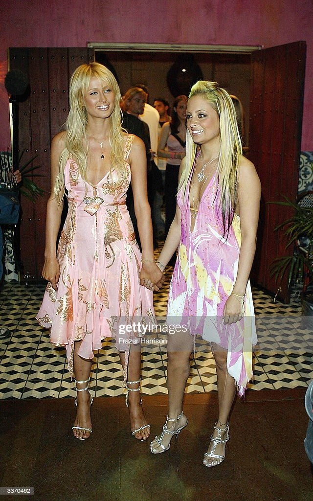 Nicole Richie (R) and Paris Hilton aririve for the 'Simple Life 2' Welcome Home Party at The Spider Club on April 14, 2004 in Hollywood, California.