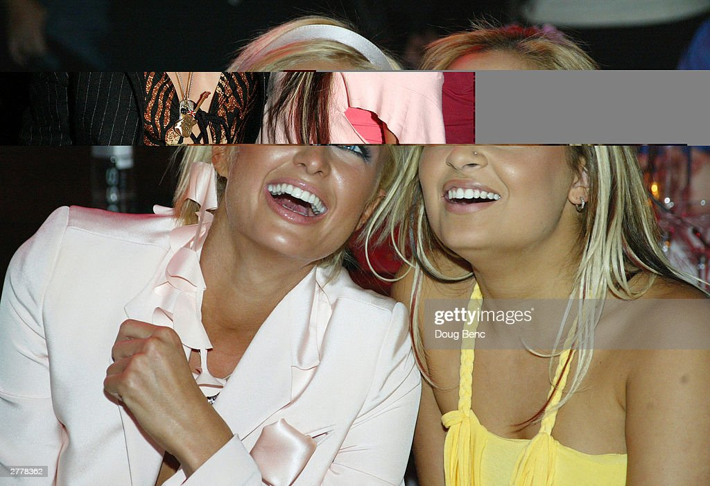 <a gi-track='captionPersonalityLinkClicked' href=/galleries/search?phrase=Nicole+Richie&family=editorial&specificpeople=201646 ng-click='$event.stopPropagation()'>Nicole Richie</a> (L) and <a gi-track='captionPersonalityLinkClicked' href=/galleries/search?phrase=Paris+Hilton&family=editorial&specificpeople=171761 ng-click='$event.stopPropagation()'>Paris Hilton</a> during the premiere party for 'The Simple Life' on December 2, 2003 at Bliss in Los Angeles, California.
