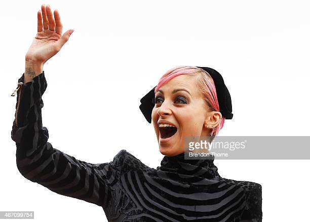Nicole Richie gestures towards the crowd during Golden Slipper Day at Royal Randwick Racecourse on March 21 2015 in Sydney Australia