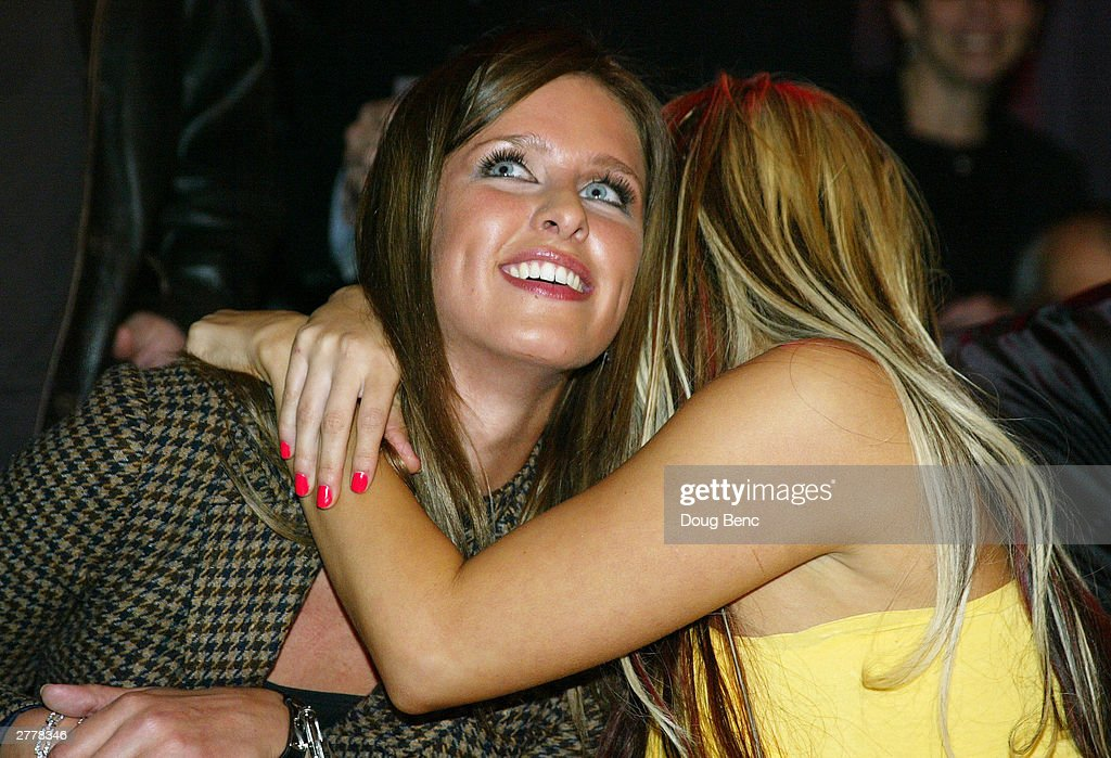 <a gi-track='captionPersonalityLinkClicked' href=/galleries/search?phrase=Nicole+Richie&family=editorial&specificpeople=201646 ng-click='$event.stopPropagation()'>Nicole Richie</a> (R) hugs Nicky Hilton during the premiere party for 'The Simple Life' on December 2, 2003 at Bliss in Los Angeles, California.