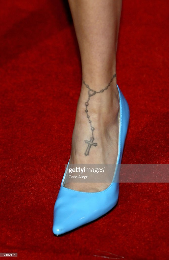 <a gi-track='captionPersonalityLinkClicked' href=/galleries/search?phrase=Nicole+Richie&family=editorial&specificpeople=201646 ng-click='$event.stopPropagation()'>Nicole Richie</a>'s ankle tattoo is seen at the 2003 Billboard Music Awards at the MGM Grand Garden Arena December 10, 2003 in Las Vegas, Nevada. The 14th annual ceremony airs live tonight on FOX 8:00-10:00 PM ET Live/PT.