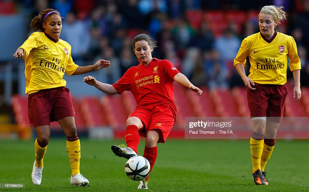 <a gi-track='captionPersonalityLinkClicked' href=/galleries/search?phrase=Nicole+Rolser&family=editorial&specificpeople=4455242 ng-click='$event.stopPropagation()'>Nicole Rolser</a> (C) of Liverpool in action with Alex Scott (L) of Arsenal during the Womens FA Cup Semi Final match between Liverpool Ladies FC and Arsenal Ladies FC at Anfield on April 26, 2013 in Liverpool, England.