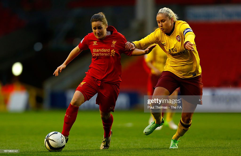 Nicole Rolser (L) of Liverpool in action with Stephanie Houghton of Arsenal during the Womens FA Cup Semi Final match between Liverpool Ladies FC and Arsenal Ladies FC at Anfield on April 26, 2013 in Liverpool, England.