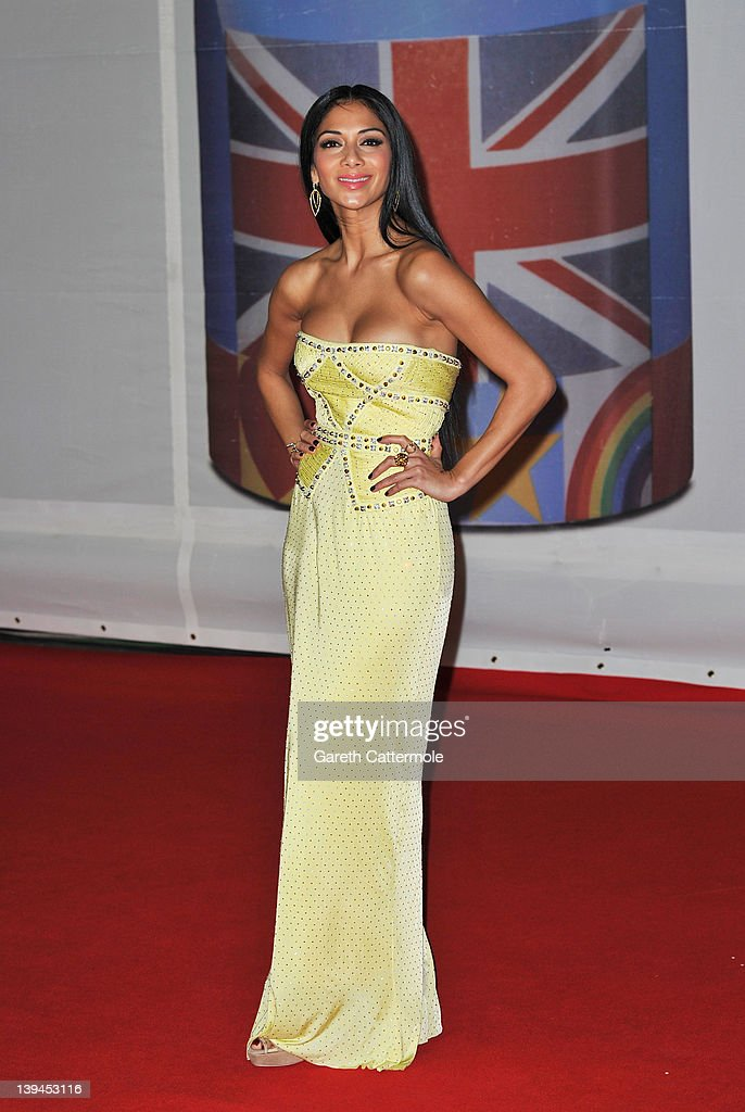 <a gi-track='captionPersonalityLinkClicked' href=/galleries/search?phrase=Nicole+Scherzinger&family=editorial&specificpeople=678971 ng-click='$event.stopPropagation()'>Nicole Scherzinger</a> attends The BRIT Awards 2012 at the O2 Arena on February 21, 2012 in London, England.