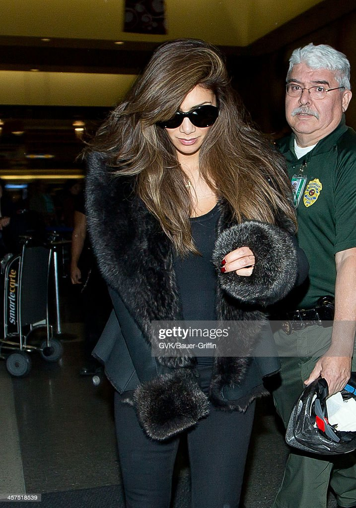 <a gi-track='captionPersonalityLinkClicked' href=/galleries/search?phrase=Nicole+Scherzinger&family=editorial&specificpeople=678971 ng-click='$event.stopPropagation()'>Nicole Scherzinger</a> is seen at Los Angeles International airport on December 17, 2013 in Los Angeles, California.