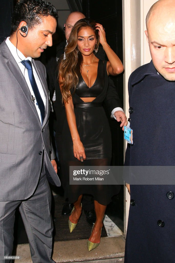 <a gi-track='captionPersonalityLinkClicked' href=/galleries/search?phrase=Nicole+Scherzinger&family=editorial&specificpeople=678971 ng-click='$event.stopPropagation()'>Nicole Scherzinger</a> leaving The Arts Club on October 23, 2013 in London, England.