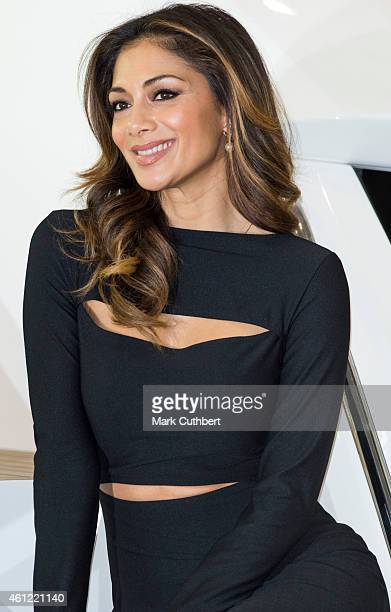 Nicole Scherzinger on The Sunseeker stand where she unveiled the new Sunseeker Predator 57 at the London Boat Show at ExCel on January 9 2015 in...