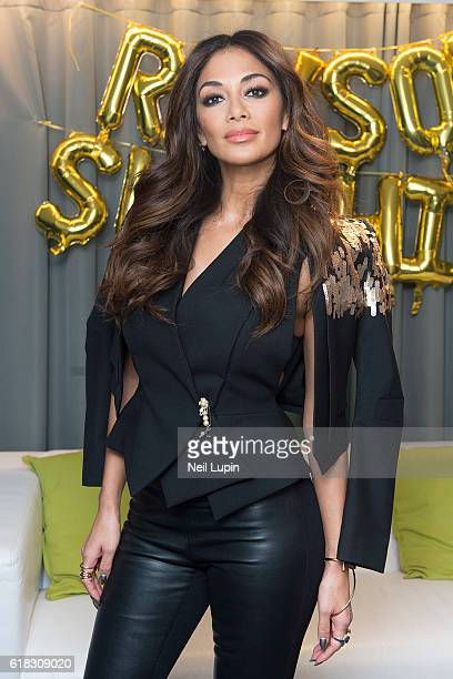 Nicole Scherzinger poses backstage ahead of her performance at the Rays of Sunshine charity concert at Wembley Arena on October 24 2016 in London...