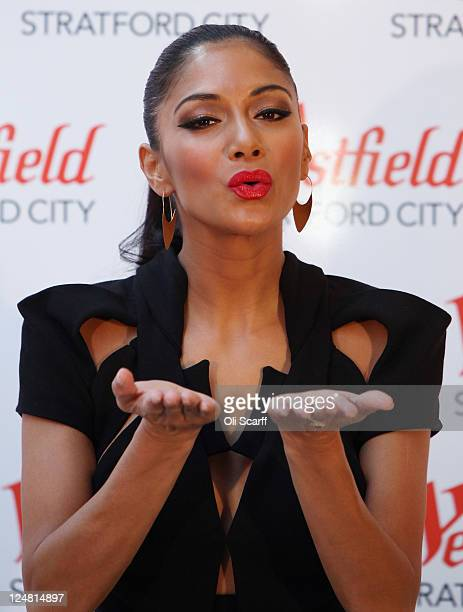 Nicole Scherzinger poses before performing at the launch of the Westfield Stratford City shopping centre on September 13 2011 in London England The...