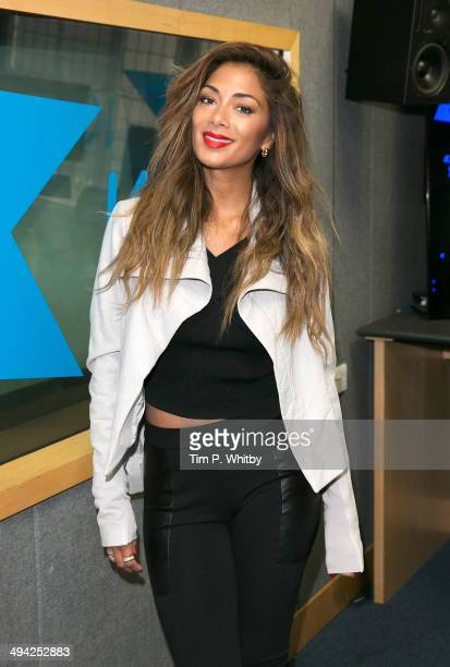 Nicole Scherzinger poses during a visit to Kiss FM Studio's on May 29 2014 in London England