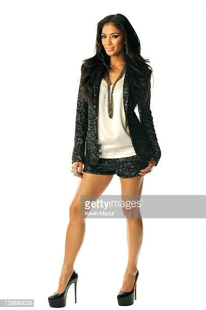 Nicole Scherzinger poses in the portrait studio at the iHeartRadio Music Festival held at the MGM Grand Garden Arena on September 24 2011 in Las...