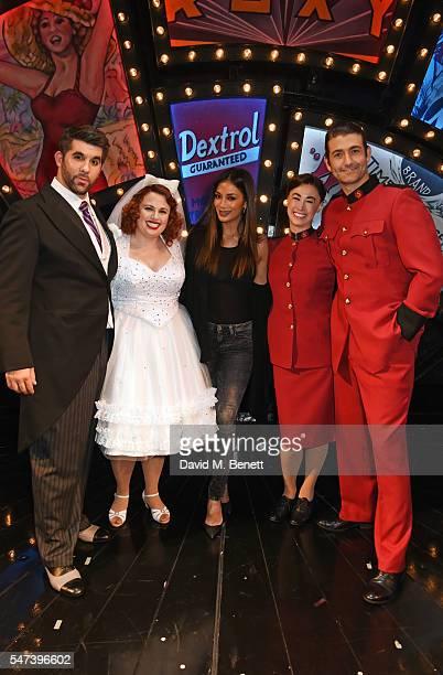 Nicole Scherzinger poses with cast members Simon Lipkin Rebel Wilson Siubhan Harrison and Oliver Tompsett pose backstage following the press night...