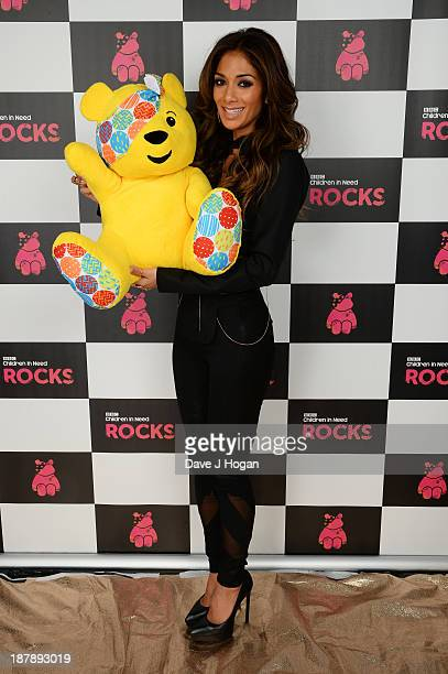 Nicole Scherzinger poses with Pudsey Bear backstage during the 'BBC Children In Need Rocks' at Hammersmith Eventim on November 13 2013 in London...