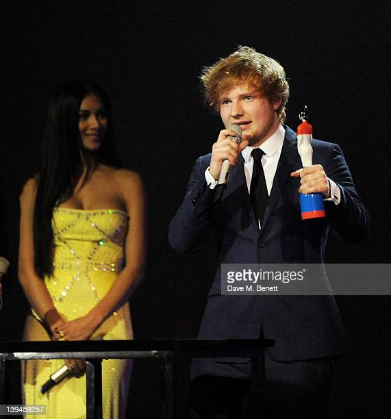 Nicole Scherzinger presents Ed Sheeran with the British Breakthrough Award during the BRIT Awards 2012 held at the O2 Arena on February 21 2012 in...