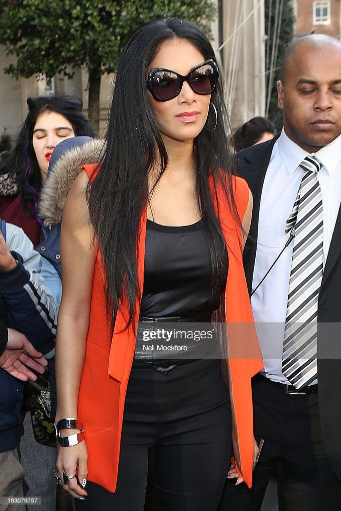 <a gi-track='captionPersonalityLinkClicked' href=/galleries/search?phrase=Nicole+Scherzinger&family=editorial&specificpeople=678971 ng-click='$event.stopPropagation()'>Nicole Scherzinger</a> seen leaving The Langham Hotel on March 4, 2013 in London, England.