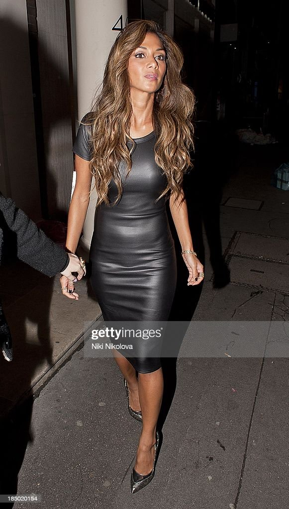 <a gi-track='captionPersonalityLinkClicked' href=/galleries/search?phrase=Nicole+Scherzinger&family=editorial&specificpeople=678971 ng-click='$event.stopPropagation()'>Nicole Scherzinger</a> sighted leaving the Arts Club, Mayfair on October 16, 2013 in London, England.