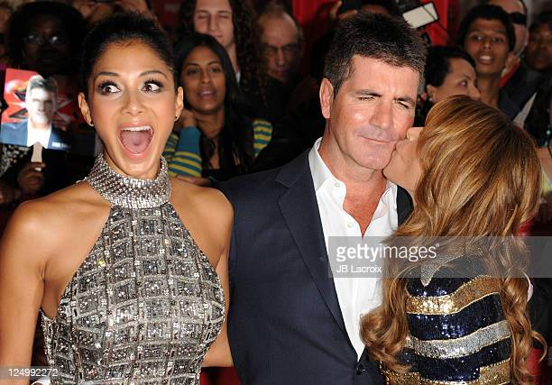 Nicole Scherzinger Simon Cowell and Paula Abdul attend 'The X Factor' World Premiere Screening at ArcLight Cinemas on September 14 2011 in Hollywood...