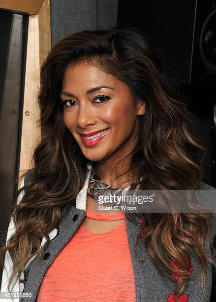 COVERAGE Nicole Scherzinger visits KissFM at Kiss FM Studio's on July 10 2014 in London England